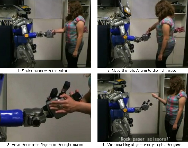 Image of the experiment - playing rock paper scissors with a humanoid robot